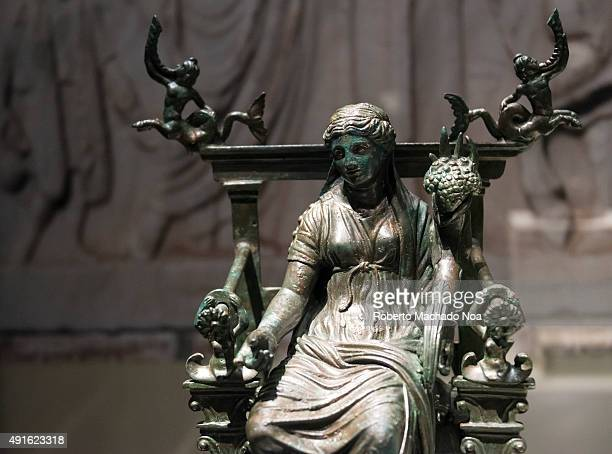 Bronze statue of a woman sitting on a throne belonging to Pompeii archaeological collection on display at the Royal Ontario Museum The Royal Ontario...