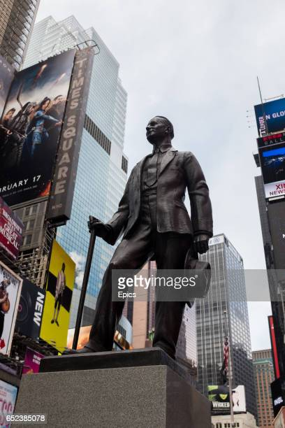 A bronze statue of American entertainer songwriter playwright composer and producer George M Cohan in Times Square New York the statue by artist...