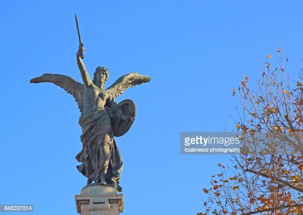 bronze statue of angel holding a sword