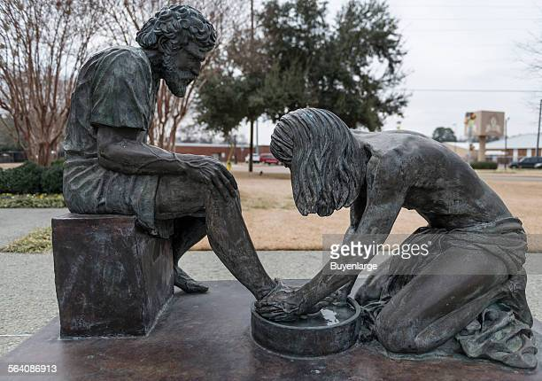 Bronze statue of Jesus washing the disciple Peter feet in Witness Park outside the Prayer Tower perhaps the most recognizable landmark in Pittsburg...