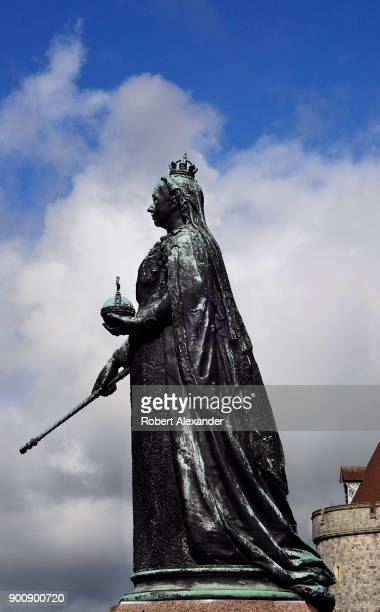 A bronze statue of Queen Victoria stands in front of Windsor Castle in Windsor England The statue unveiled in 1887 was made by the sculptor Joseph...