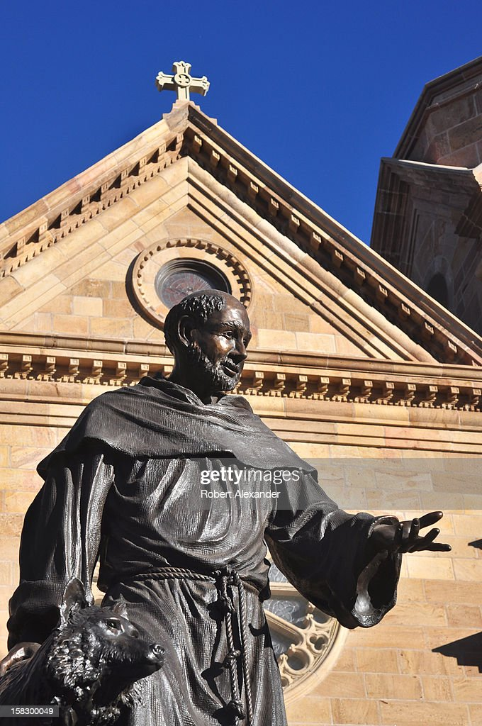 A bronze statue of Saint Francis of Assisi stands in front of the Cathedral Basilica of Saint Francis of Assisi in Santa Fe, New Mexico. (Photo by Robert Alexander/Archive Photos/Getty Images) 5104602RA_SantaFe174.jpg