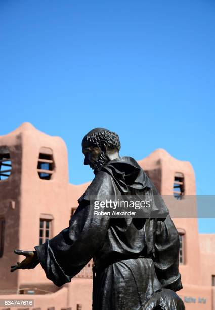 A bronze statue of St Francis of Assisi stands in front of The Cathedral Basilica of St Francis of Assisi commonly known as Saint Francis Cathedral...