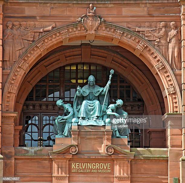 bronze statue of st mungo and two female figures, glasgow - kelvingrove art gallery and museum stock pictures, royalty-free photos & images