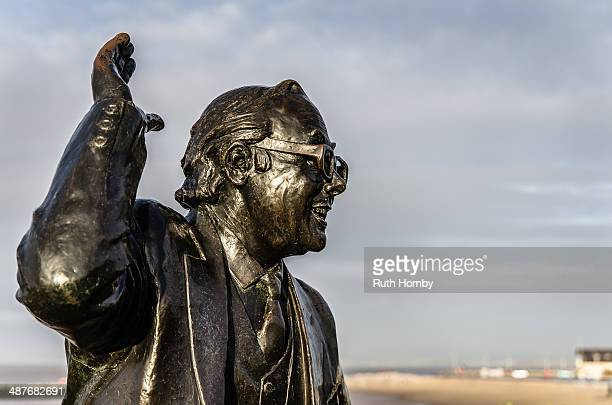 Bronze statue of the comedian Eric Morecambe, one half of the comedy duo Morecambe and Wise. Located on the seafront in the town of Morecambe,...