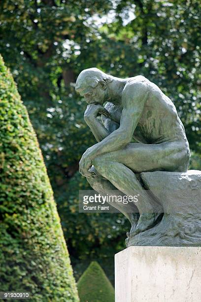 bronze statue on post