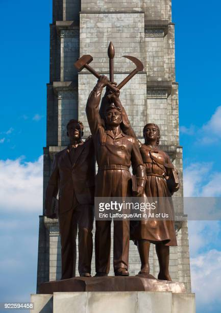Bronze statues at the bottom of the Juche tower built to commemorate Kim ilsung's 70th birthday Pyongan Province Pyongyang North Korea on September 9...
