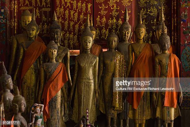 bronze statues in a buddhist temple, luang prabang, laos, southeast asia - laotian culture stock pictures, royalty-free photos & images