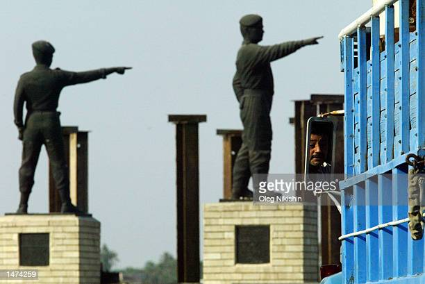 Bronze statues of Iraqi officers who died in the IranIraq war are seen while a driver is reflected in the rearview mirror of his truck October 11...
