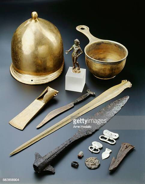 Bronze statuette of a Donor Bronze Roman saucepan Bronze axe Bronze knife Bronze sword Iron spearhead with wings Silver belt buckles Horn harpoon...