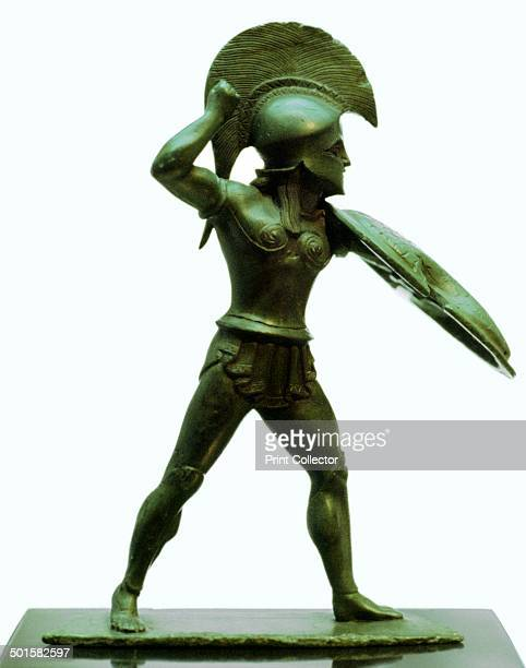 A bronze statuette of a Greek hoplite warrior missing his spear