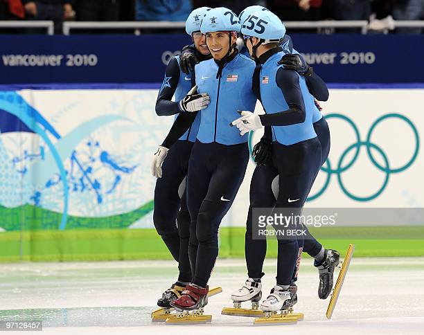 Bronze US medallists US Apolo Anton Ohno JR Celski and Jordan Malone celebrate at the end of the Men's 5000 m relay shorttrack final at the Pacific...