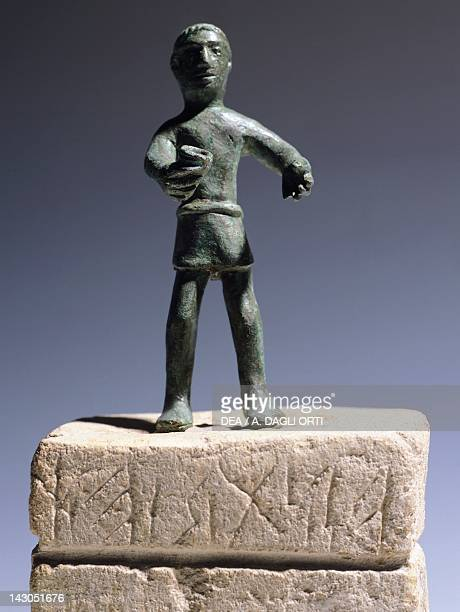 Bronze votive statue with an inscription on the pedestal Veneto Italy Paleoveneti Civilization Este Museo Nazionale Atestino
