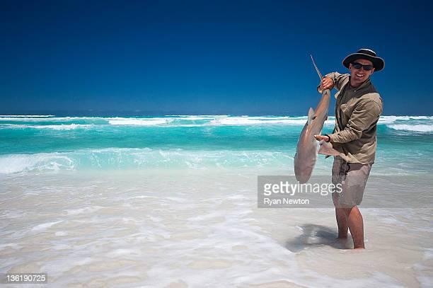 Bronze whaler fisherman