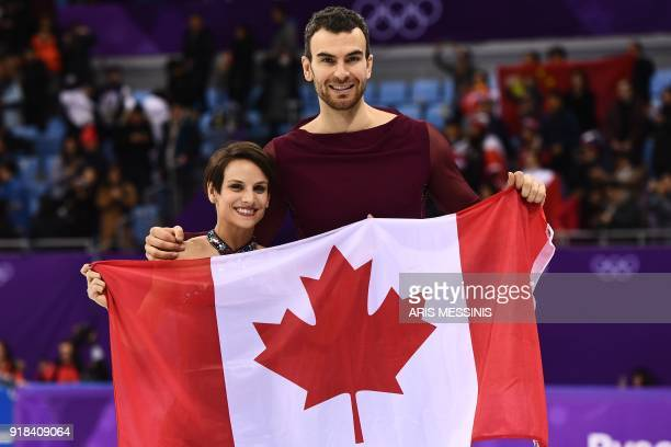 TOPSHOT Bronze winners Canada's Meagan Duhamel and Canada's Eric Radford pose with their national flag following the venue ceremony after the pair...