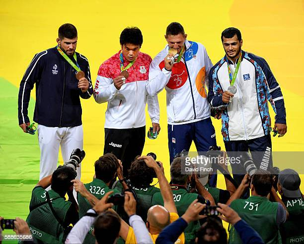 Bronzes Cyrille Maret of France and Ryunosuke Haga of Japan Gold Lukas Krpalek of the Czech Republic and Silver Elmar Gasimov of Azerbaijan during...