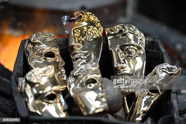 Bronzes faces are readied of the iconic masks cast in to the BAFTA trophy for the 2016 British Academy of Film and Television Arts award ceremony at...