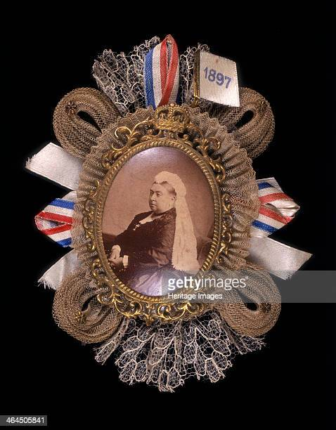Brooch commemorating Queen Victoria's diamond jubilee 1897 Queen Victoria is surrounded by a gold frame ribbons and laces