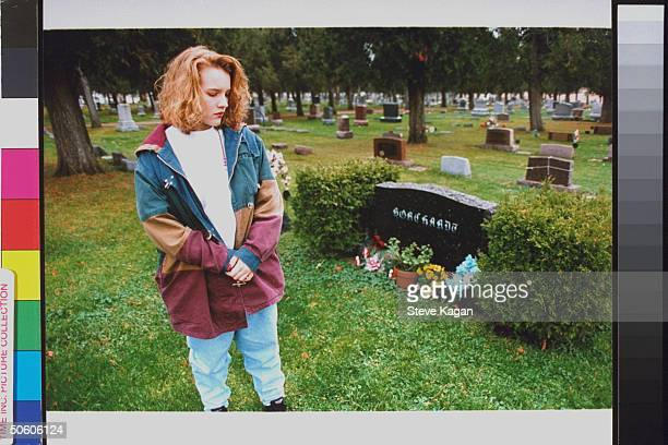 Brook Borchardt standing nr grave of father Ruben who was murdered by 3 teens hired by her stepmother Diane at cemetery