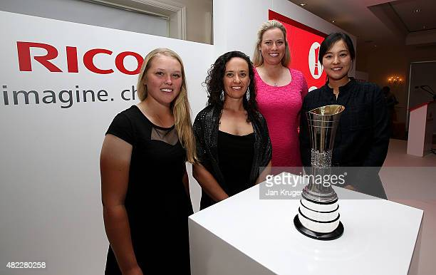 Brook Henderson of Canada Mo Martin of the United States Brittany Lincicome of the United States and In Gee Chun of South Korea pose with the trophy...