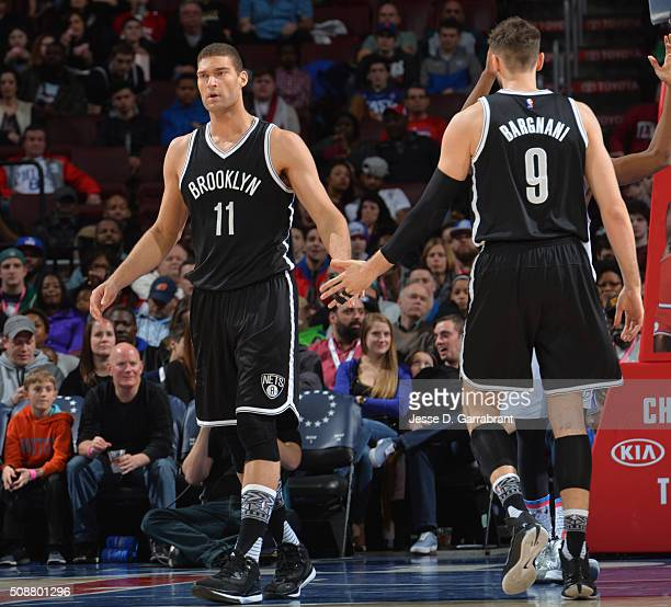 Brook Lopez and Andrea Bargnani of the Brooklyn Nets shake hands against the Philadelphia 76ers at Wells Fargo Center on February 6 2016 in...