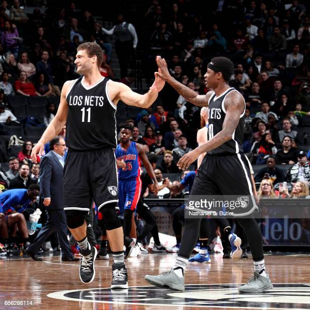 Brook Lopez and Archie Goodwin of the Brooklyn Nets react during the game against the Detroit Pistons on March 21 2017 at Barclays Center in Brooklyn...