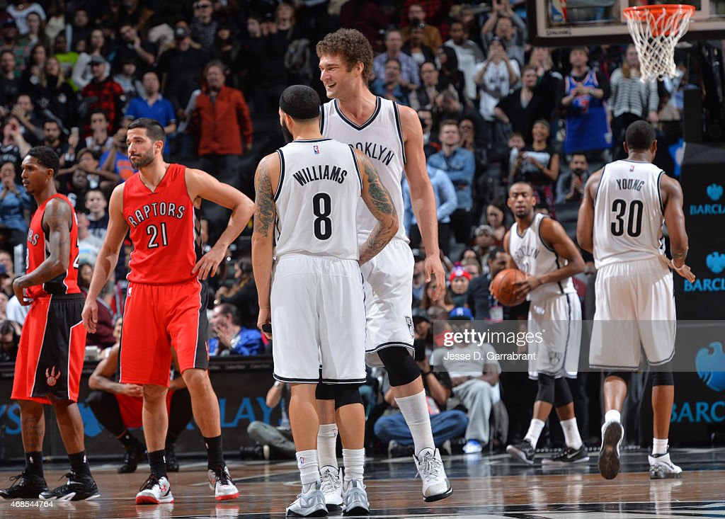 Brook Lopez #11 and Deron Williams #8 of the Brooklyn Nets smile after the WIN against the Toronto Raptors at Barclays Center on April 3, 2015 in Brooklyn, New York