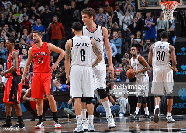 Brook Lopez and Deron Williams of the Brooklyn Nets smile after the WIN against the Toronto Raptors at Barclays Center on April 3 2015 in Brooklyn...