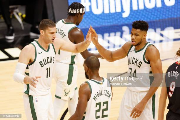 Brook Lopez and Giannis Antetokounmpo of the Milwaukee Bucks celebrate a play against the Miami Heat during the first quarter at American Airlines...