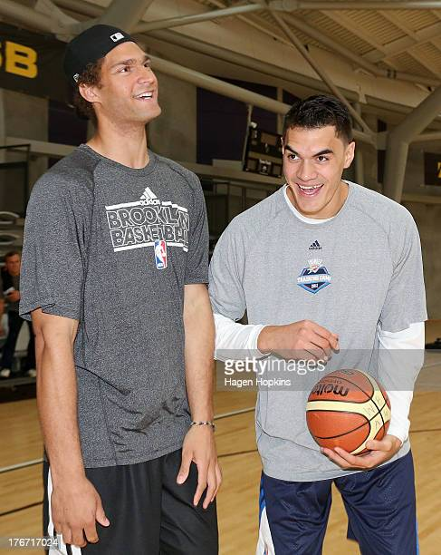 Brook Lopez and Steven Adams joke around during a New Zealand Basketball Academy training camp at ASB Sports Centre on August 18 2013 in Wellington...