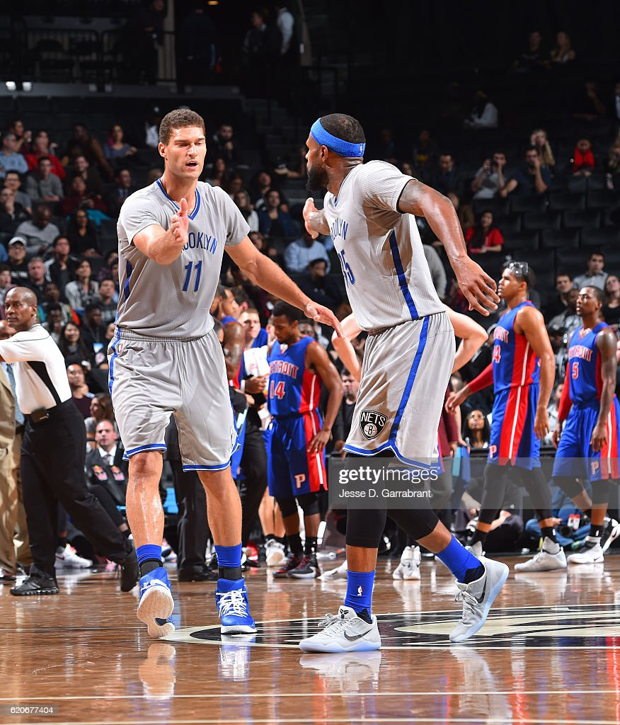 Brook Lopez #11 and Trevor Booker #35 of the Brooklyn Nets shake hands against the Detroit Pistons on November 2,2016 at Barclays Center in Brooklyn, New York.