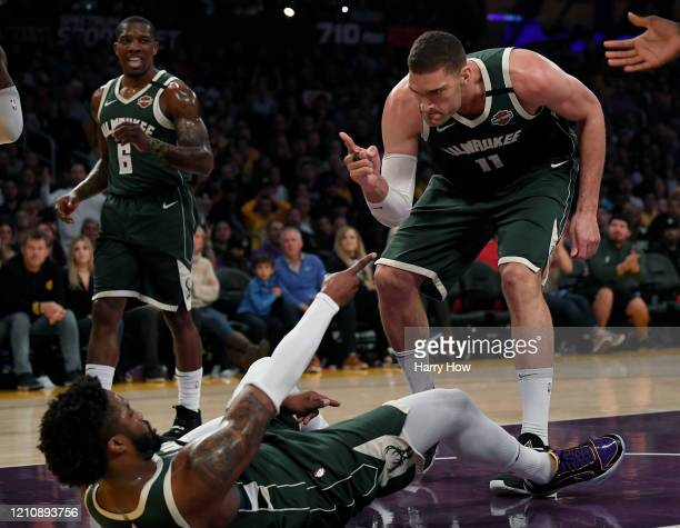 Brook Lopez and Wesley Matthews of the Milwaukee Bucks reacts to an offensive foul of LeBron James of the Los Angeles Lakers during the first half at...