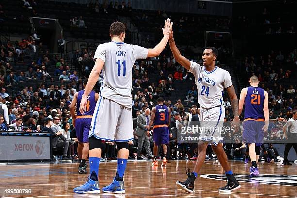 Brook Lopez high fives Rondae HollisJefferson of the Brooklyn Nets during the game on December 1 2015 at Barclays Center in Brooklyn New York NOTE TO...