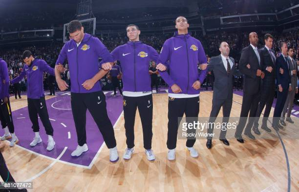 Brook Lopez Lonzo Ball and Kyle Kuzma of the Los Angeles Lakers link arms during the national anthem of the game against the Sacramento Kings on...