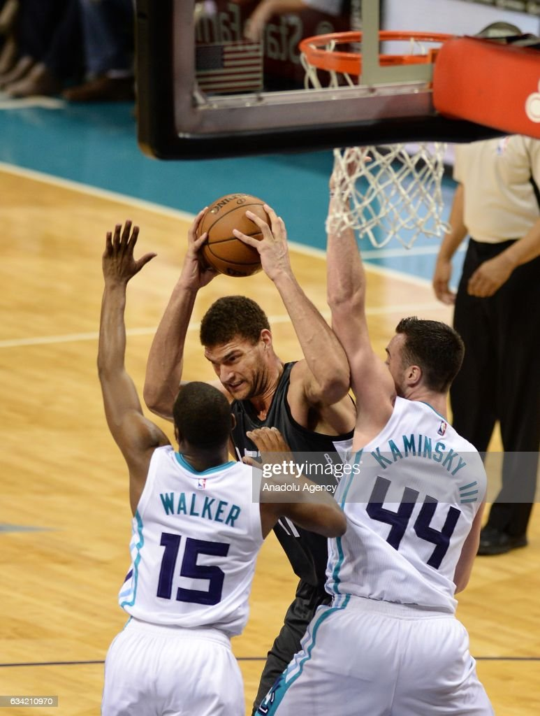 Brook Lopez (C) of Brooklyn Nets fights Kemba Walker and Frank Kaminsky of Charlotte Hornets during the NBA match between Brooklyn Nets vs Charlotte Hornets at the Spectrum arena in Charlotte, NC, USA on February 7, 2017.