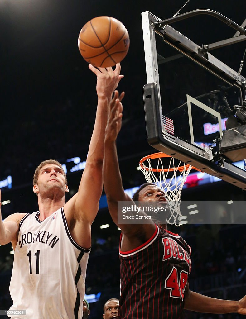 Brook Lopez #11 of the Brooklyn Nets and Nazr Mohammed #48 of the Chicago Bulls battle for the ball at the Barclays Center on April 4, 2013 in New York City. The Bulls defeated the Nets 92-90.
