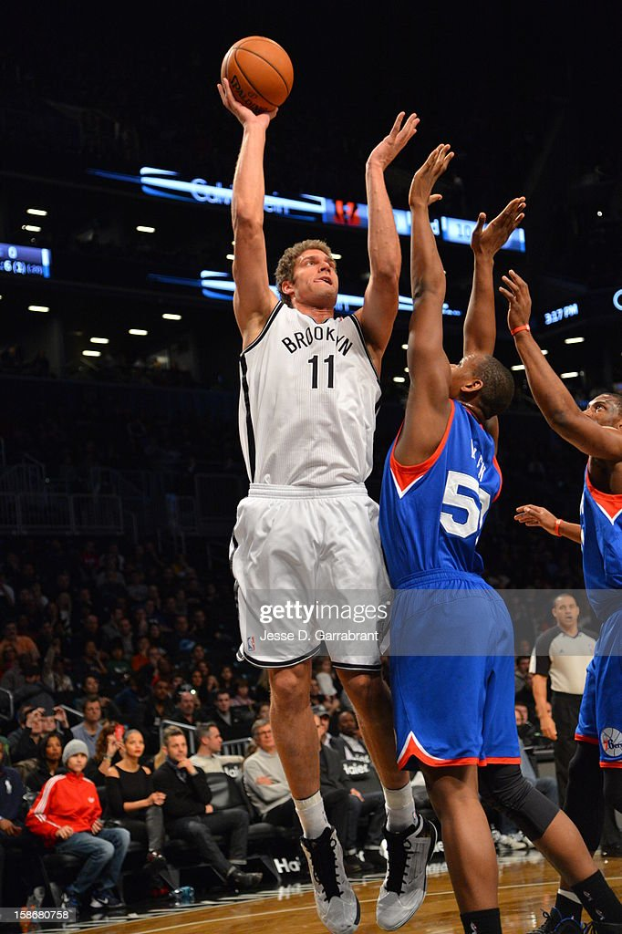 Brook Lopez #11 of the Brooklyn Nets attempts a hook shot against the Philadelphia 76ers during the game at the Barclays Center on December 23, 2012 in Brooklyn, New York.