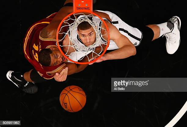 Brook Lopez of the Brooklyn Nets battles Tristan Thompson of the Cleveland Cavaliers for the ball during their game at the Barclays Center on January...