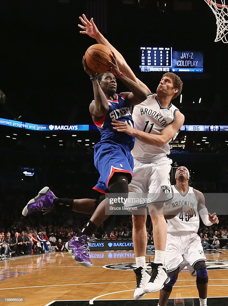 Brook Lopez #11 of the Brooklyn Nets blocks a shot by Jrue Holiday #11 of the Philadelphia 76ers during second half action at Barclays Center on December 23, 2012 in the Brooklyn borough of New York City.