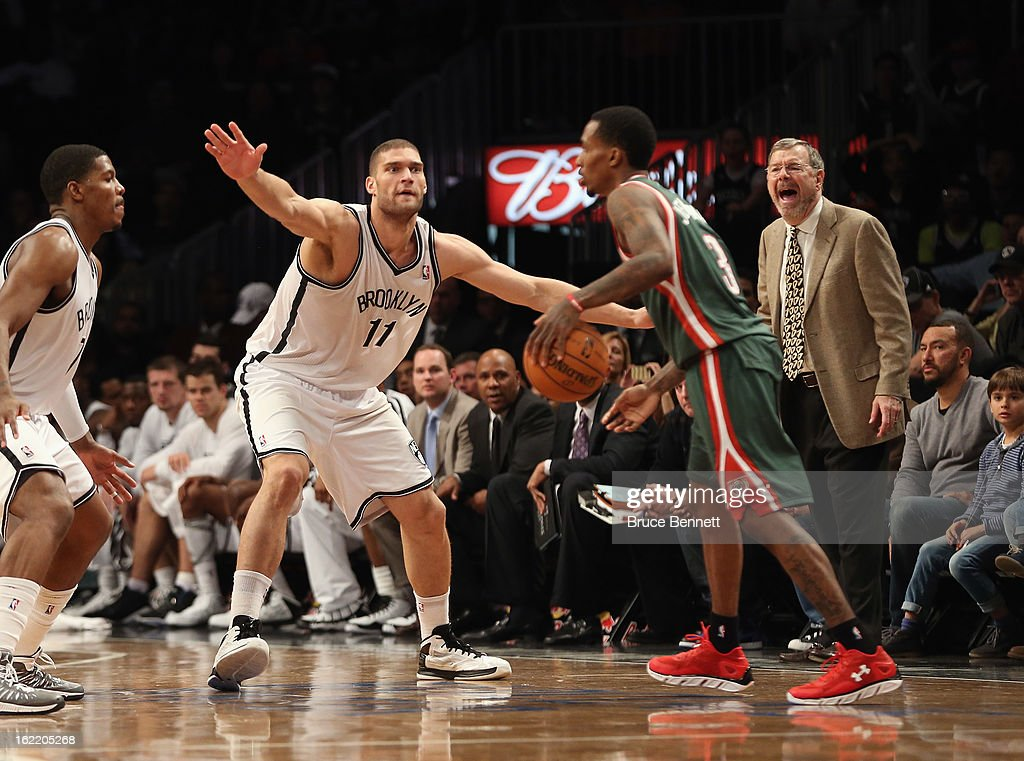 Brook Lopez #11 of the Brooklyn Nets blocks Brandon Jennings #3 of the Milwaukee Bucks at the Barclays Center on February 19, 2013 in New York City.