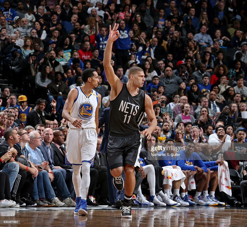 Brook Lopez #11 of the Brooklyn Nets celebrates a three point basket against the Golden State Warriors on December 22, 2016 at Barclays Center in Brooklyn, NY.