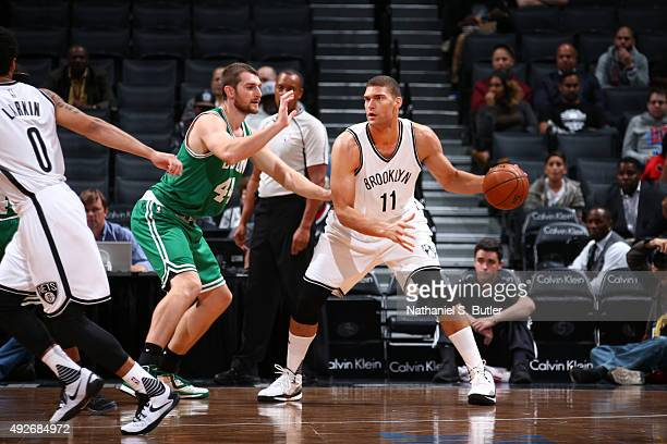 Brook Lopez of the Brooklyn Nets defends the ball against the Boston Celtics during the preseason game on October 14 2015 at Barclays Center in...
