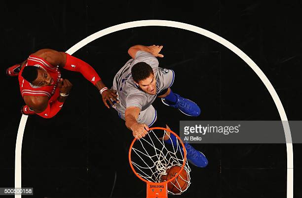 Brook Lopez of the Brooklyn Nets dunks against Dwight Howard of the Houston Rockets during their game at the Barclays Center on December 8 2015 in...