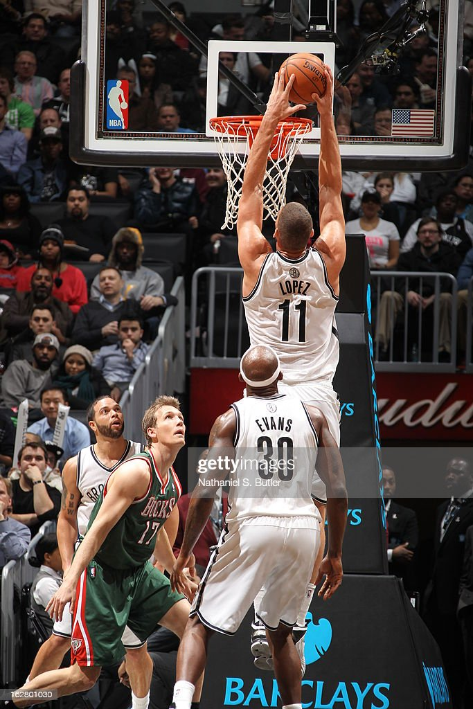 Brook Lopez #11 of the Brooklyn Nets dunks the ball against the Milwaukee Bucks on February 19, 2013 at the Barclays Center in the Brooklyn borough of New York City.