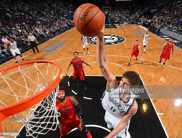 Brook Lopez of the Brooklyn Nets dunks the ball against the Toronto Raptors at Barclays Center on April 3 2015 in Brooklyn New York NOTE TO USER User...