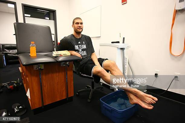 Brook Lopez of the Brooklyn Nets ices his foot before a game against the Atlanta Hawks in Game Three of the Eastern Conference Quarterfinals during...