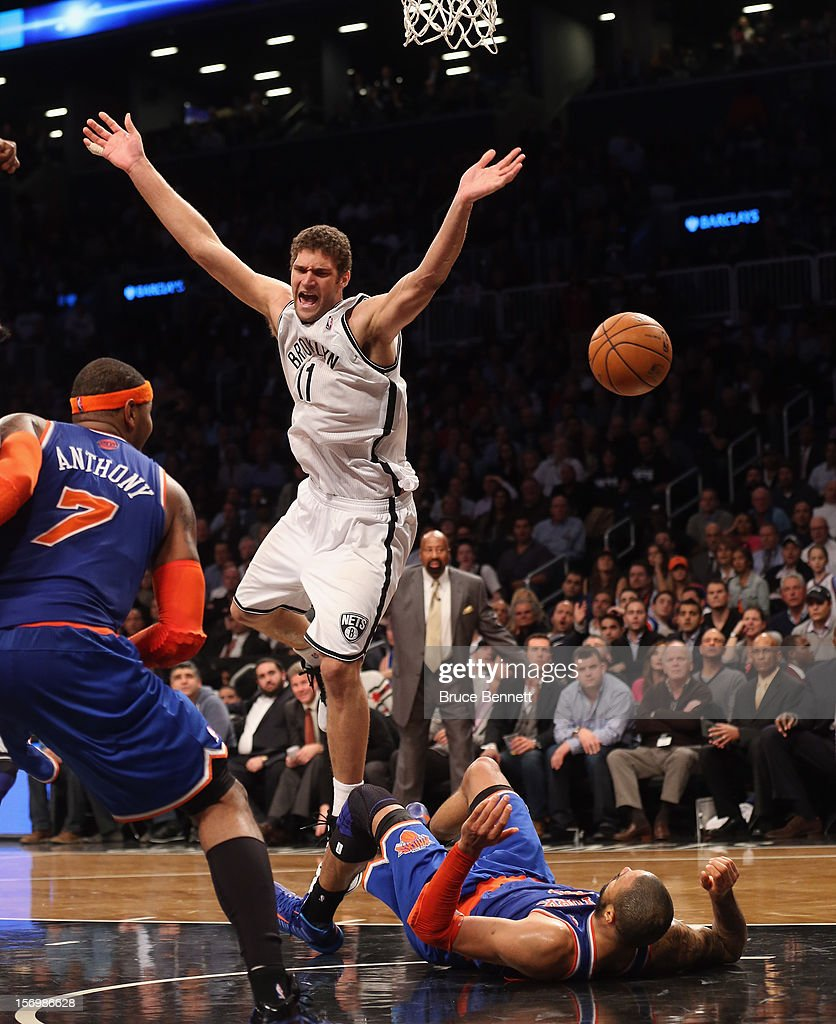 Brook Lopez #11 of the Brooklyn Nets is called for an offensive foul against Tyson Chandler #6 of the New York Knicks in the final minute of regulation at the Barclays Center on November 26, 2012 in the Brooklyn borough of New York City.