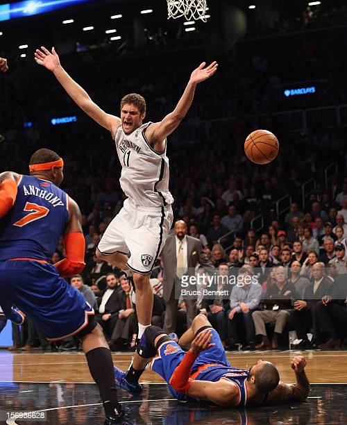 Brook Lopez of the Brooklyn Nets is called for an offensive foul against Tyson Chandler of the New York Knicks in the final minute of regulation at...
