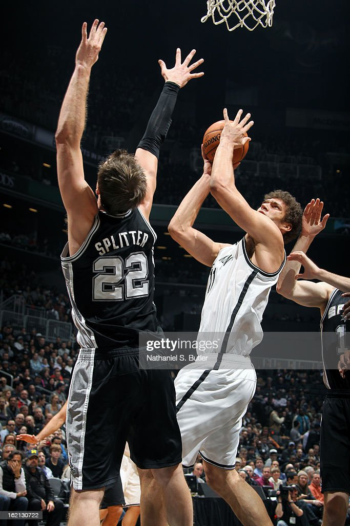 Brook Lopez #11 of the Brooklyn Nets puts up a shot against the San Antonio Spurs on February 10, 2013 at the Barclays Center in the Brooklyn borough of New York City.