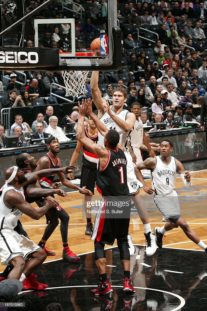 Brook Lopez #11 of the Brooklyn Nets puts up a shot over Jared Jeffries #1 of the Portland Trail Blazers on November 25, 2012 at the Barclays Center in the Brooklyn Borough of New York City.